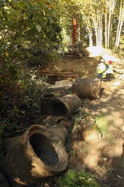An old pipe in place since the 1950s was removed to make way for a 16-foot-wide culvert at Kabelac Creek in Gorst.