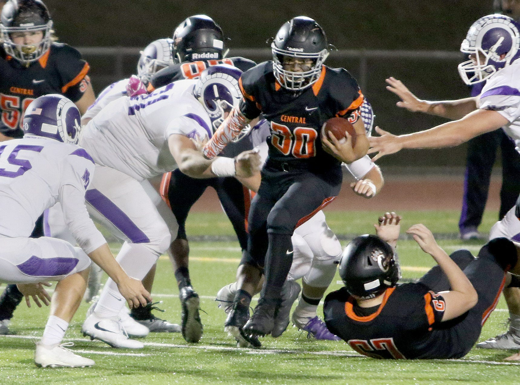 Central Kitsap running back Alex Refilong finds an opening in the North Thurston line for positive yards in a game played Thursday night at Silverdale Stadium.