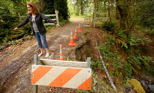 FILE Property owner Deborah Vedin talks about the collapse of one of the culverts and the loss of one side of the bridge of her driveway at her Gorst home on Friday, July 1, 2016. (MEEGAN M. REID / KITSAP SUN)