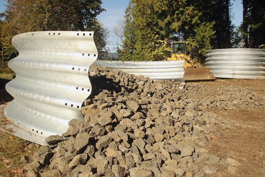 A 16-foot-wide culvert awaits installation at Kabelac Creek in Gorst, Thursday, Oct. 11, 2018.