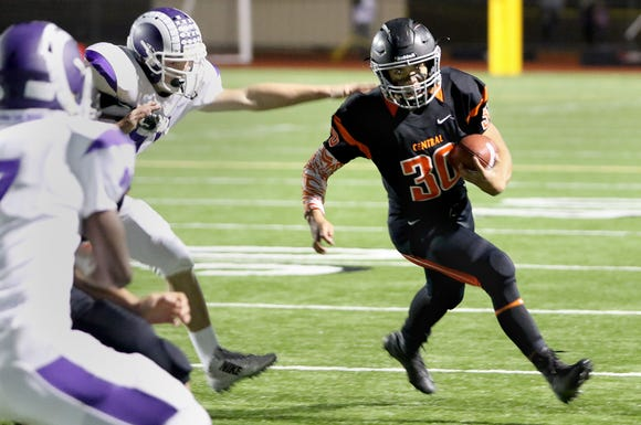 Central Kitsap running back Alex Refilong finds room around the end against North Thurston line for positive yards in the first quarter of a game played Thursday night at Silverdale Stadium.
