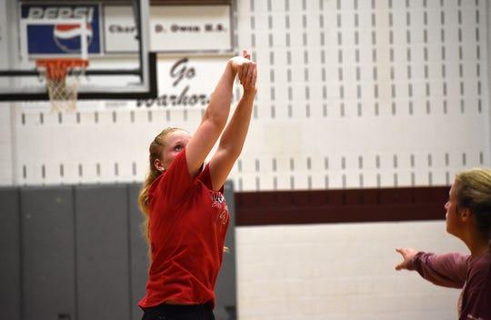 Junior Alyssa Watson follows through on a jumper during an open gym on Oct. 10.