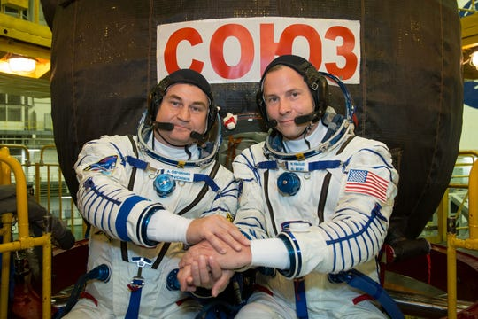 Expedition 57 crew members Alexey Ovchinin of Roscosmos (left) and Nick Hague of NASA (right) posed for pictures in front of their Soyuz MS-10 spacecraft.