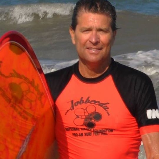 Bill Hahn, shown surfing in an undated photo, was co-founder of the annual Footprints in the Sand walk at Cocoa Beach.