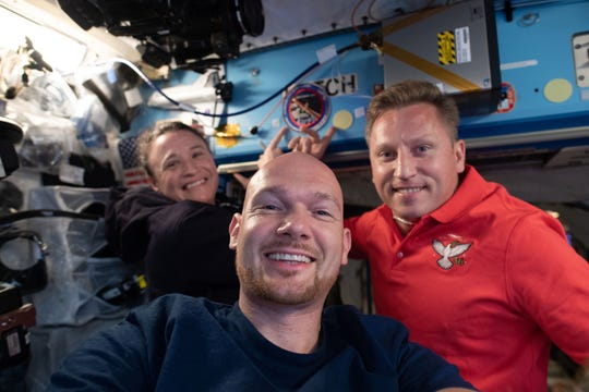 Expedition 56-57 crewmates, from left, Serena Auñón-Chancellor of NASA, Alexander Gerst of the European Space Agency, and Sergey Prokopyev of Roscosmos pose for a portrait aboard the International Space Station.