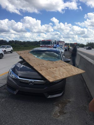 Plywood narrowly misses driver on Interstate 95.