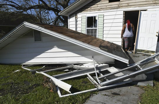 Sheila Dukes heads into what's left of her Panama City rental home after Hurricane Michael struck in October.