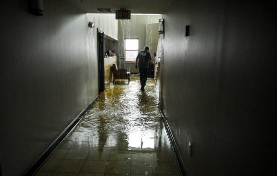 Water pours into the lobby of the Country Inn and Suites in Panama City Wednesday. Part of the roof was removed by Hurricane Michael  Mandatory Credit: Craig Bailey/FLORIDA TODAY via USA TODAY NETWORK