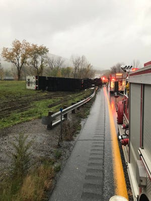 A tractor trailer rolled over on Interstate 89 on Thursday, Oct. 11, 2018, after Vermont State Police say it was traveling too fast for conditions.
