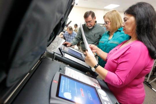 In this file photo, Dee Stokes (from left), Yolanda Martinez and Olivia Gutierrez test elections equipment at the Nueces County Courthouse in 2014.