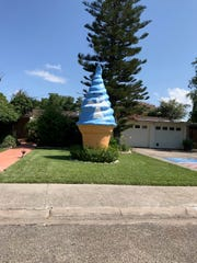 "The giant ice cream cone statue that sits in a yard on Wilshire Place was painted blue with an angel and ""in loving memory"" after homeowner Jennifer Dawn died in July 2018."