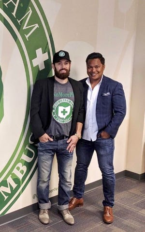 Ryan Brown and Brandon Durbin opened the Ohio Green Team medical marijuana clinic in Upper Arlington to connect doctors with more patients who are looking for an alternative for chronic pain treatment.