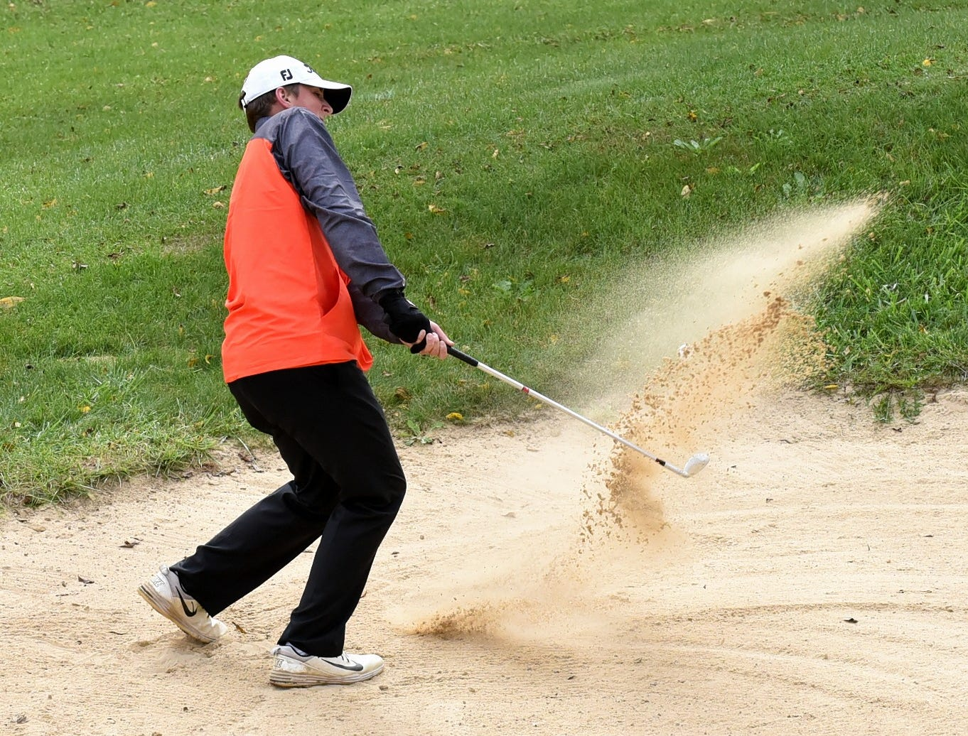 Peter Barton of Anderson battles the sandtrap on the back nine at the 2018 Southwest District Golf Tournament in Beavercreek, Ohio, October 11, 2018.
