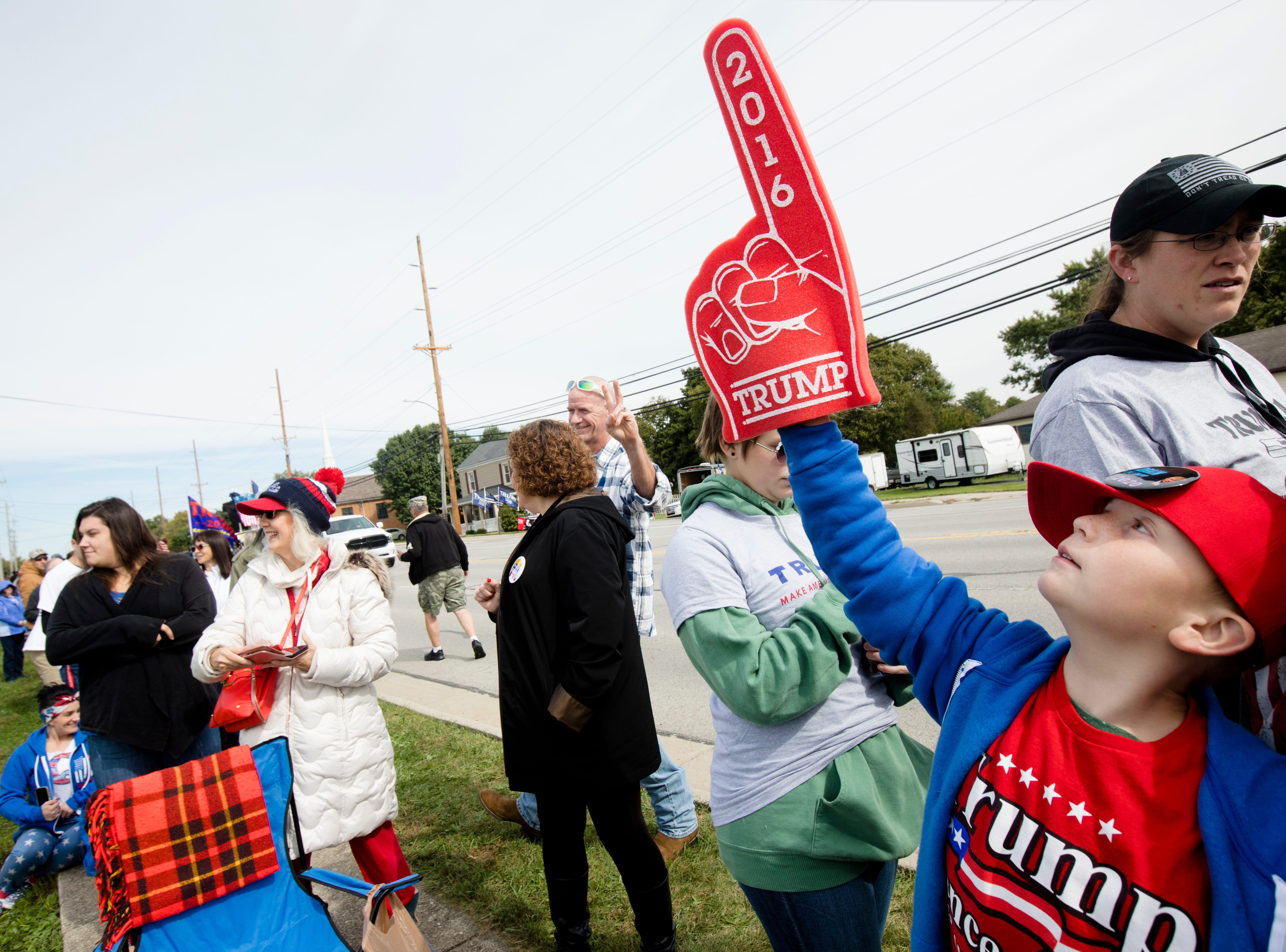Cody Lawrence, 8, of Centerburg, Ohio, Holds up his hand  while waiting in line for President Donald J. Trump's Make America Great Again Rally in Lebanon, Ohio, on Friday, Oct. 12, 2018.