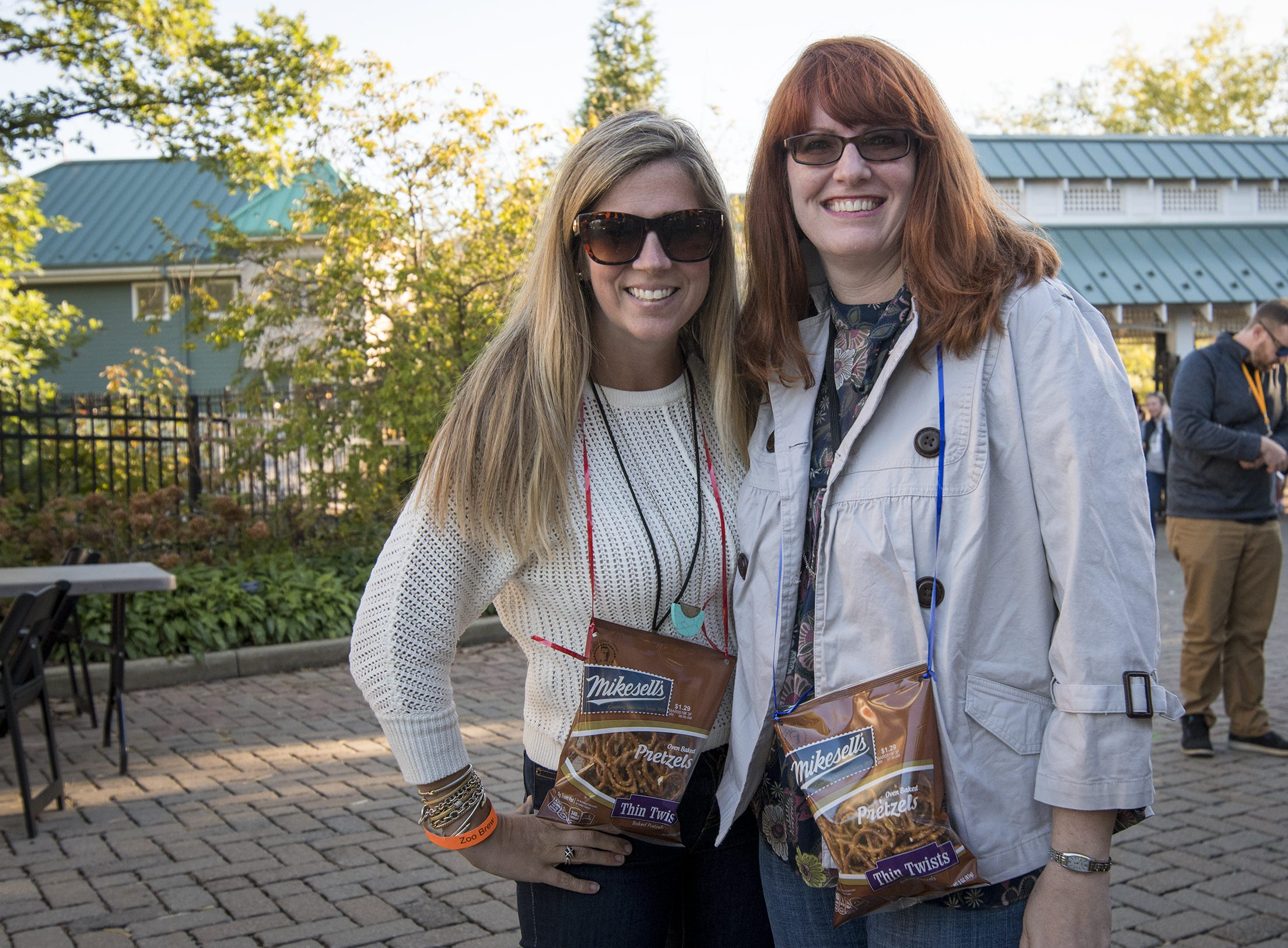 Jillian Scherzinger of Oakley and Jenny Matthews of Eastgate attend Zoo Brew.