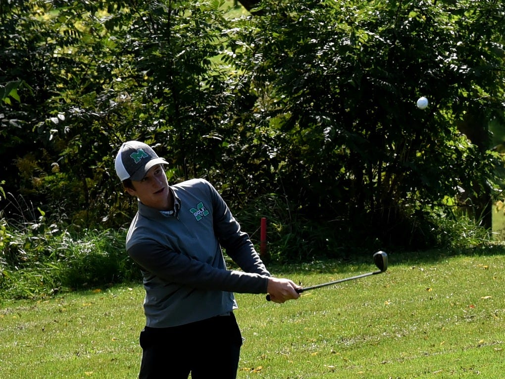 Mason's Jack Soper hits a pitch shot on the back nine at the 2018 Southwest District Golf Tournament in Beavercreek, Ohio, October 11, 2018.