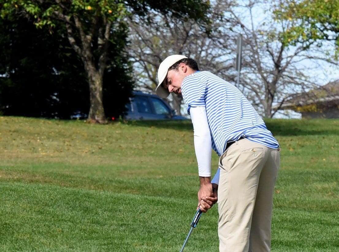 St. Xavier's Oscar Zimmerman eyes a strong finish on the18th hole at the 2018 Southwest District Golf Tournament in Beavercreek, Ohio, October 11, 2018.