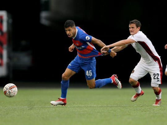 FC Cincinnati midfielder Emmanuel Ledesma (45) escapes with the ball in the first half during the USL soccer game between Atlanta United 2 and FC Cincinnati, Saturday, May 5, 2018, at Nippert Stadium in Cincinnati. FC Cincinnati led 3-2 at halftime.