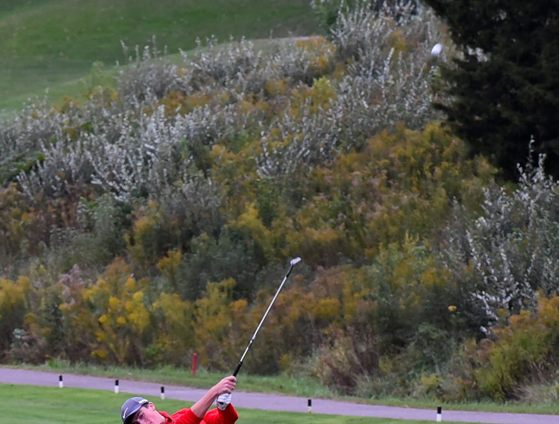 Fairfield's Chandler Kellum lauches his second shot from the fairway  fringe to the green at the 2018 Southwest District Golf Tournament in Beavercreek, Ohio, October 11, 2018.