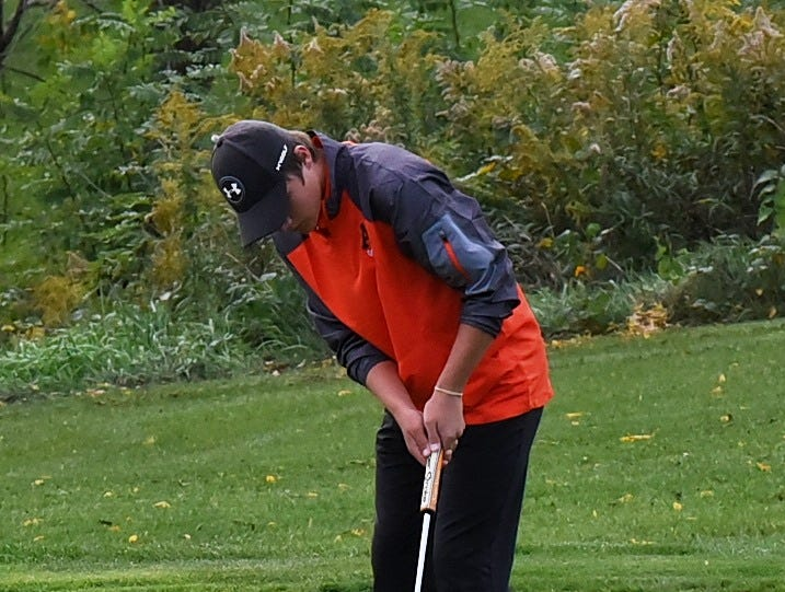 Jackson Miller of Anderson eyes his putt to the hole on the 18th green at the 2018 Southwest District Golf Tournament in Beavercreek, Ohio, October 11, 2018.
