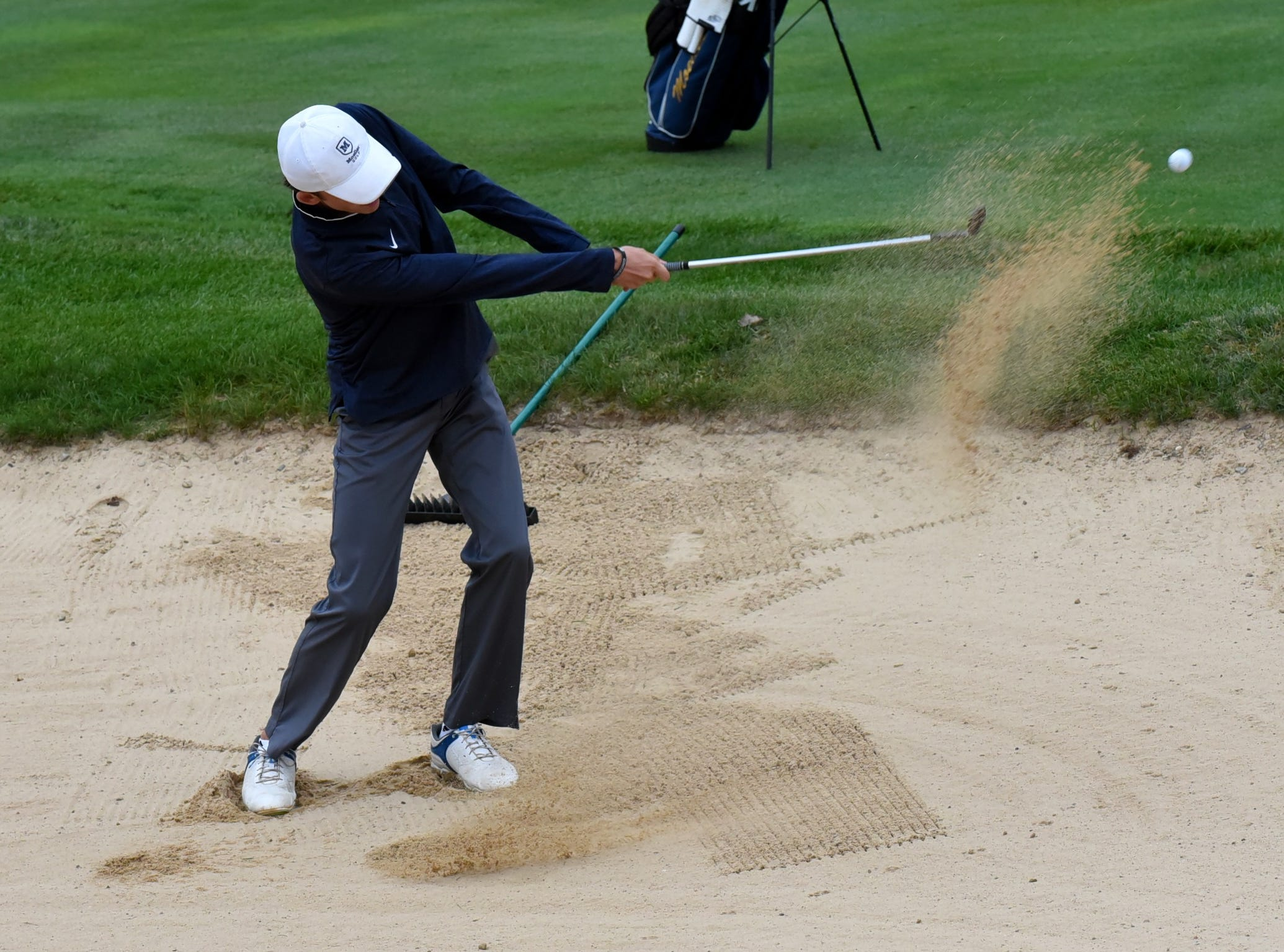 Ryan Kelly of Moeller clears the sandtrap on the first hole at the 2018 Southwest District Golf Tournament in Beavercreek, Ohio, October 11, 2018.