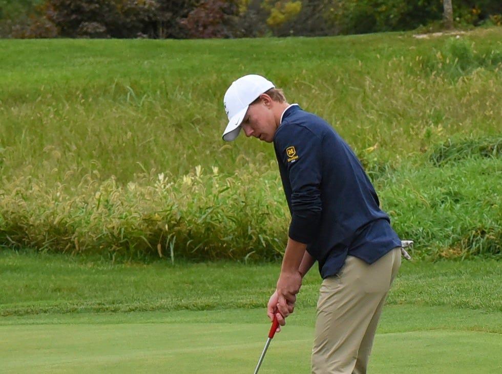 Moeller's Matt Daulton drops in a short putt for par at the 2018 Southwest District Golf Tournament in Beavercreek, Ohio, October 11, 2018.