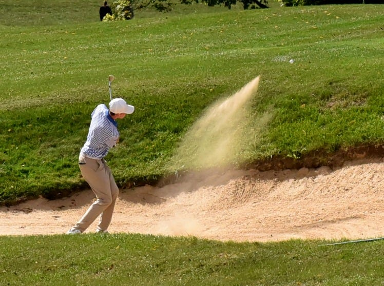 Ryan Lang of St. Xavier makes his way out of the sand on 18 at the 2018 Southwest District Golf Tournament in Beavercreek, Ohio, October 11, 2018.