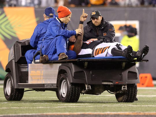 Cincinnati Bengals outside linebacker Vontaze Burfict (55) gestures as he's carted off the field in the fourth quarter during the Week 13 NFL game between the Pittsburgh Steelers and the Cincinnati Bengals, Tuesday, Dec. 5, 2017, at Paul Brown Stadium in Cincinnati. Pittsburgh won 23-20.