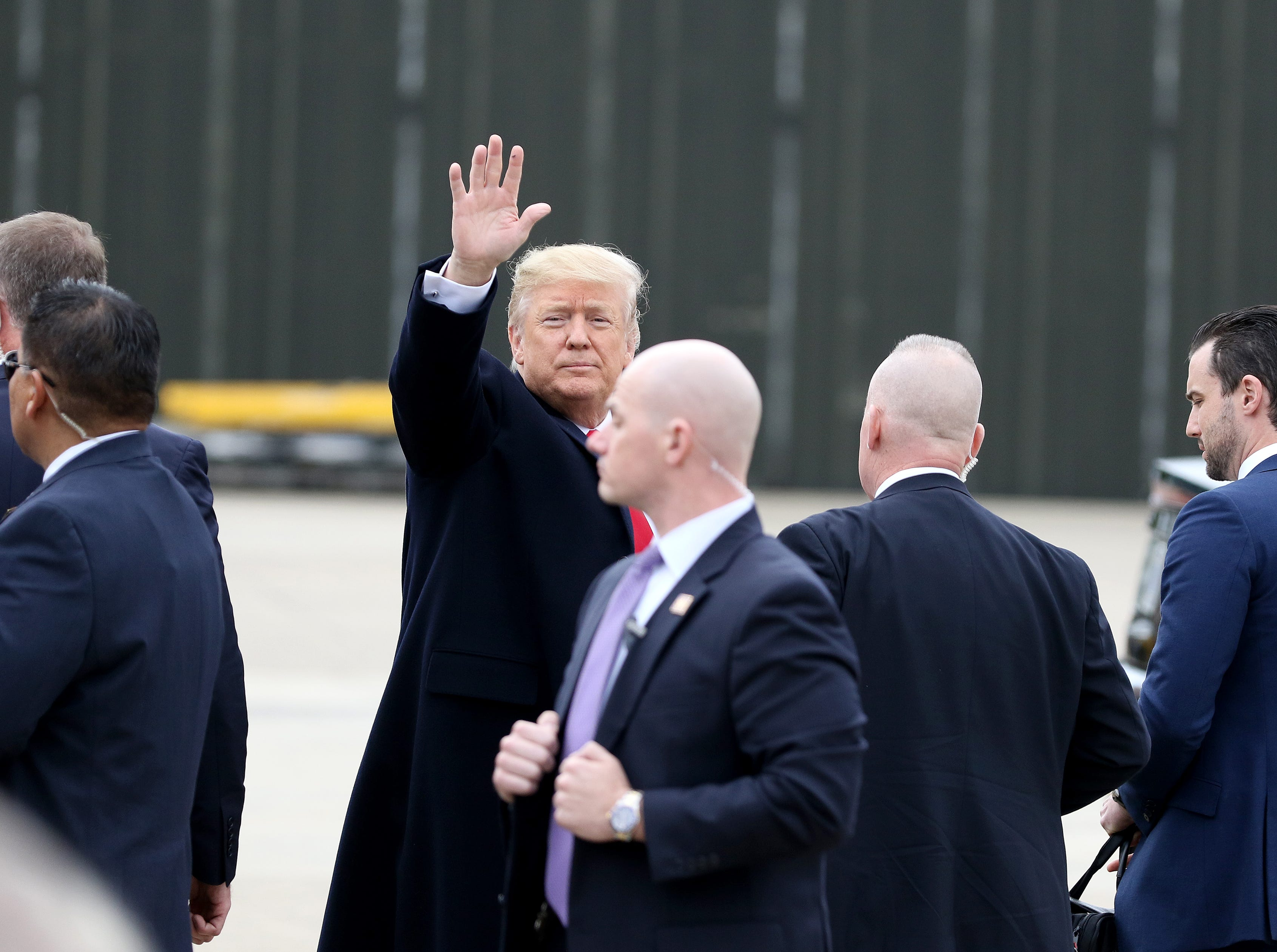 President Donald Trump waves to supporters at Lunken Airport Friday, October 12, 2018 for a Make America Great Again (MAGA) rally in Lebanon.