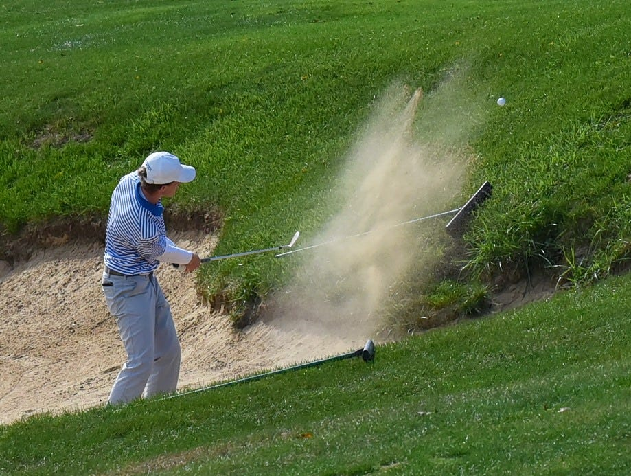 Henry Perry of St. Xavier fires out of the sand on the back nine at the 2018 Southwest District Golf Tournament in Beavercreek, Ohio, October 11, 2018.