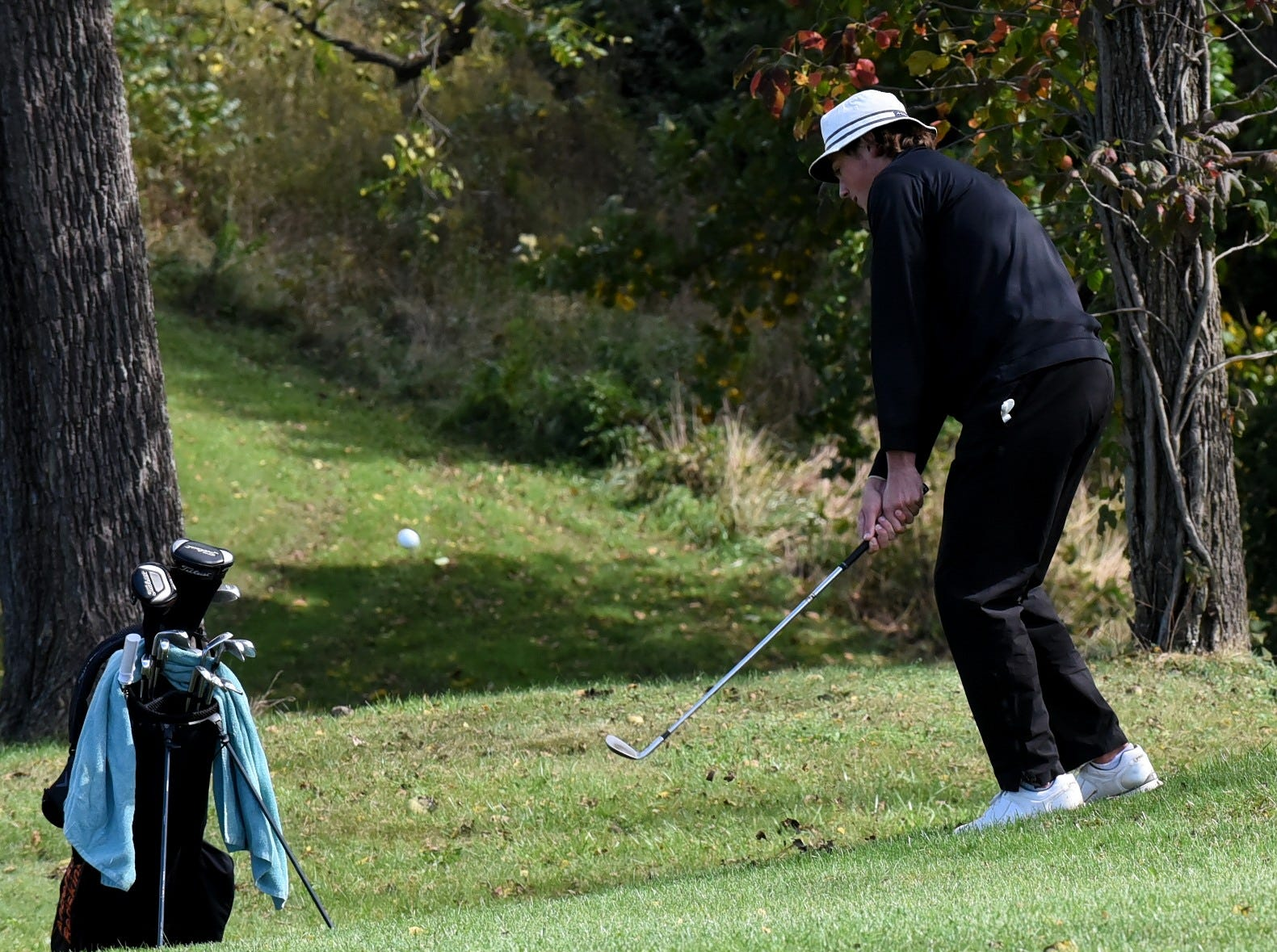 Joe Vosel of Anderson pitches his way to the green at the 2018 Southwest District Golf Tournament in Beavercreek, Ohio, October 11, 2018.