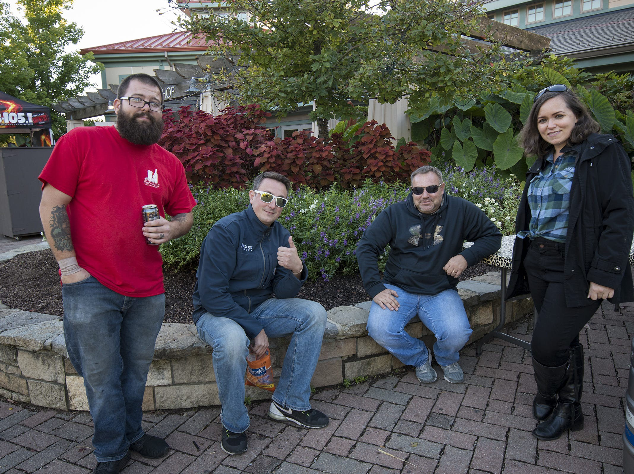 Casey Caudill, Brett DiMarcello, Jason Sexton and Susan Bernstein represent local breweries during Zoo Brew.