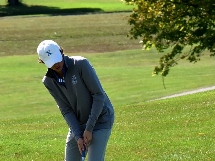 Jared DeVille of St. Xavier putts from the fringe of the green on 18 at the 2018 Southwest District Golf Tournament in Beavercreek, Ohio, October 11, 2018.