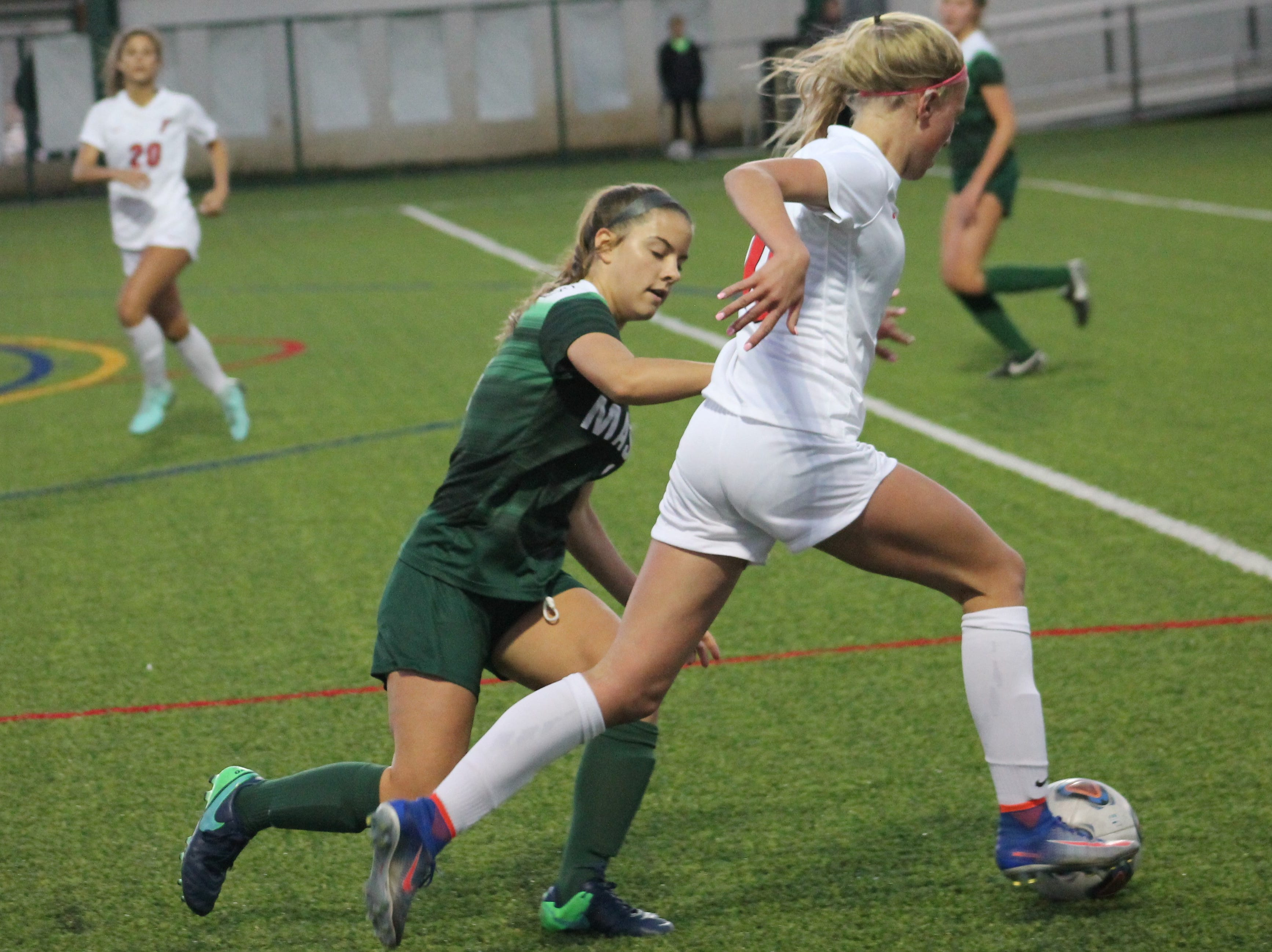Mason's Natalie Adkins tries to chase down Fairfield junior Shelby O'Leary