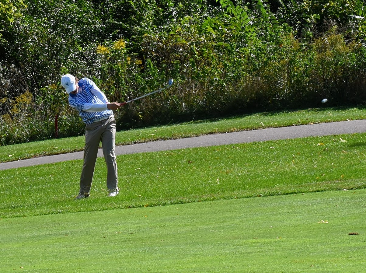 Zach Brinks of St. Xavier hits out of the rough for the Bombers at the 2018 Southwest District Golf Tournament in Beavercreek, Ohio, October 11, 2018.