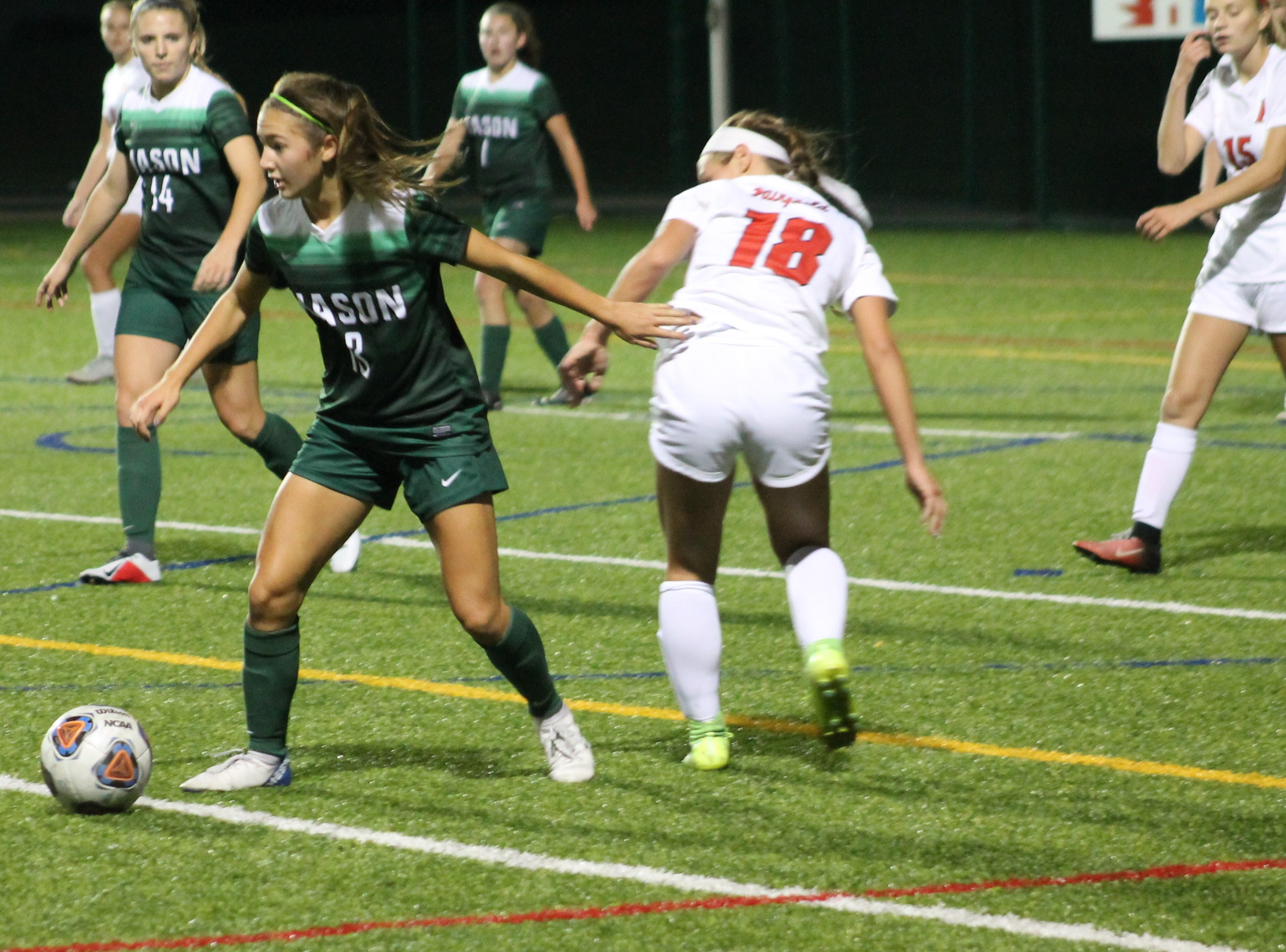 Mason sophomore Maria Speas comes away with the ball Oct. 12 against Fairfield
