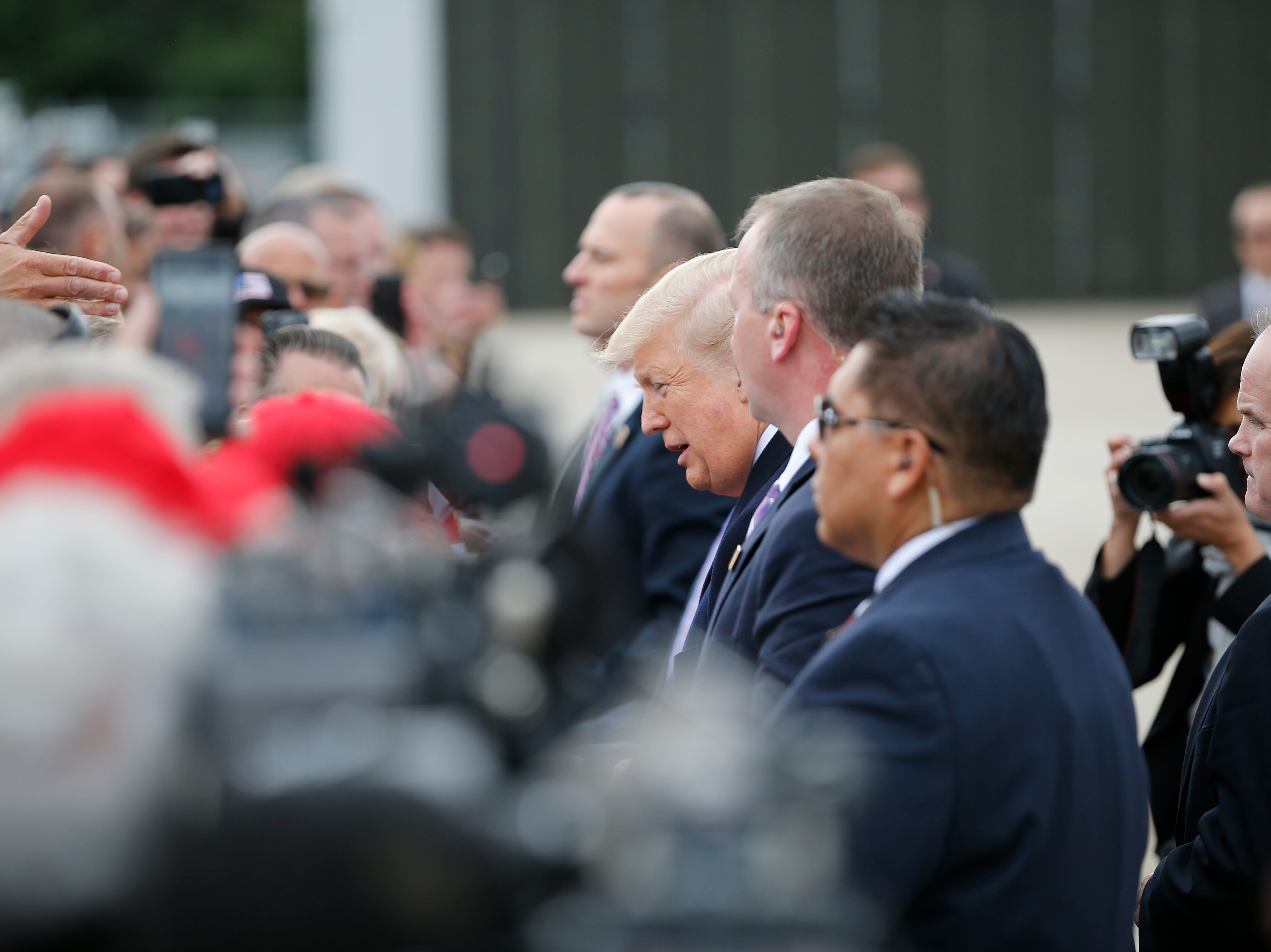 Donald Trump greets people as he arrives in Cincinnati