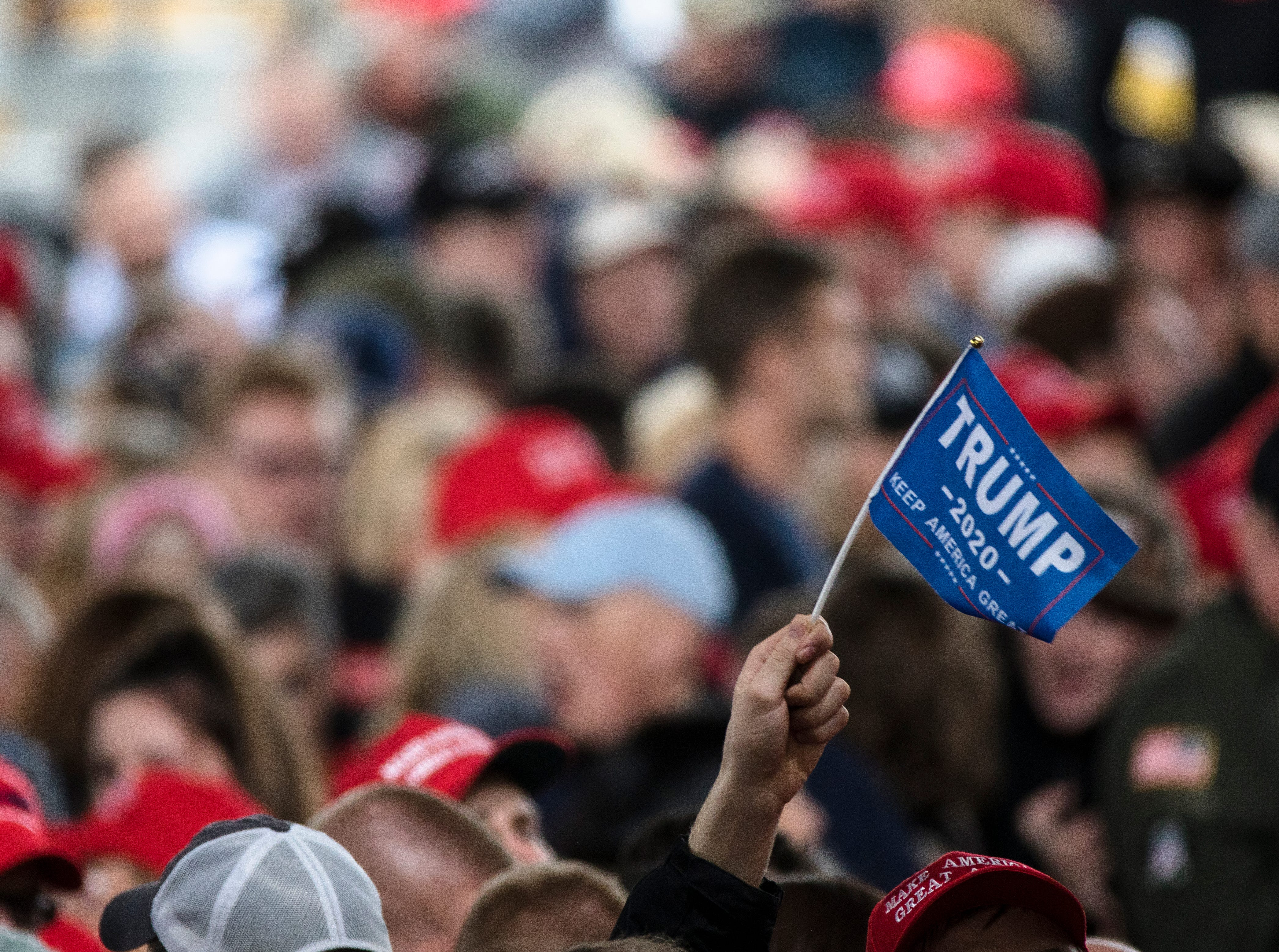 A person waives a flag while waiting for the President at President Donald J. TrumpÕs Make America Great Again Rally in Lebanon, Ohio, on Friday, Oct. 12, 2018.