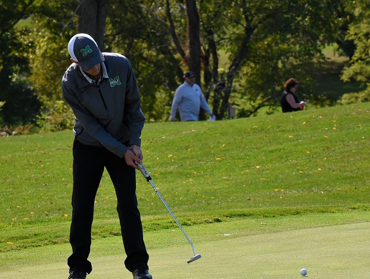 Mason's Cameron Madden eyes a par on 18 at the 2018 Southwest District Golf Tournament in Beavercreek, Ohio, October 11, 2018.