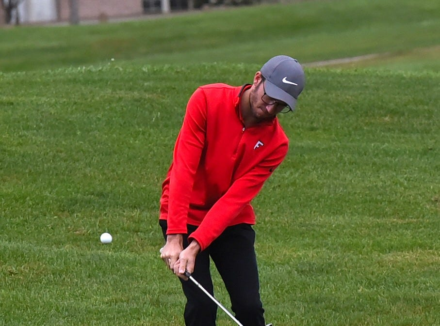Adam Luegers of Fairfield lifts his pitch shot to the green at the 2018 Southwest District Golf Tournament in Beavercreek, Ohio, October 11, 2018.