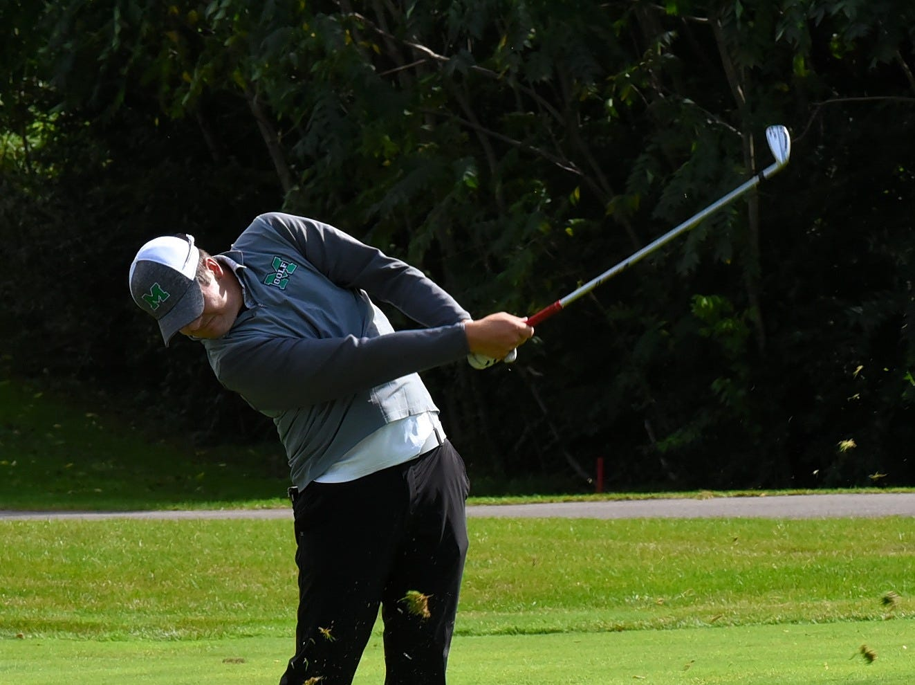 Matthew Scheid of Mason follows through on an approach shot at the 2018 Southwest District Golf Tournament in Beavercreek, Ohio, October 11, 2018.