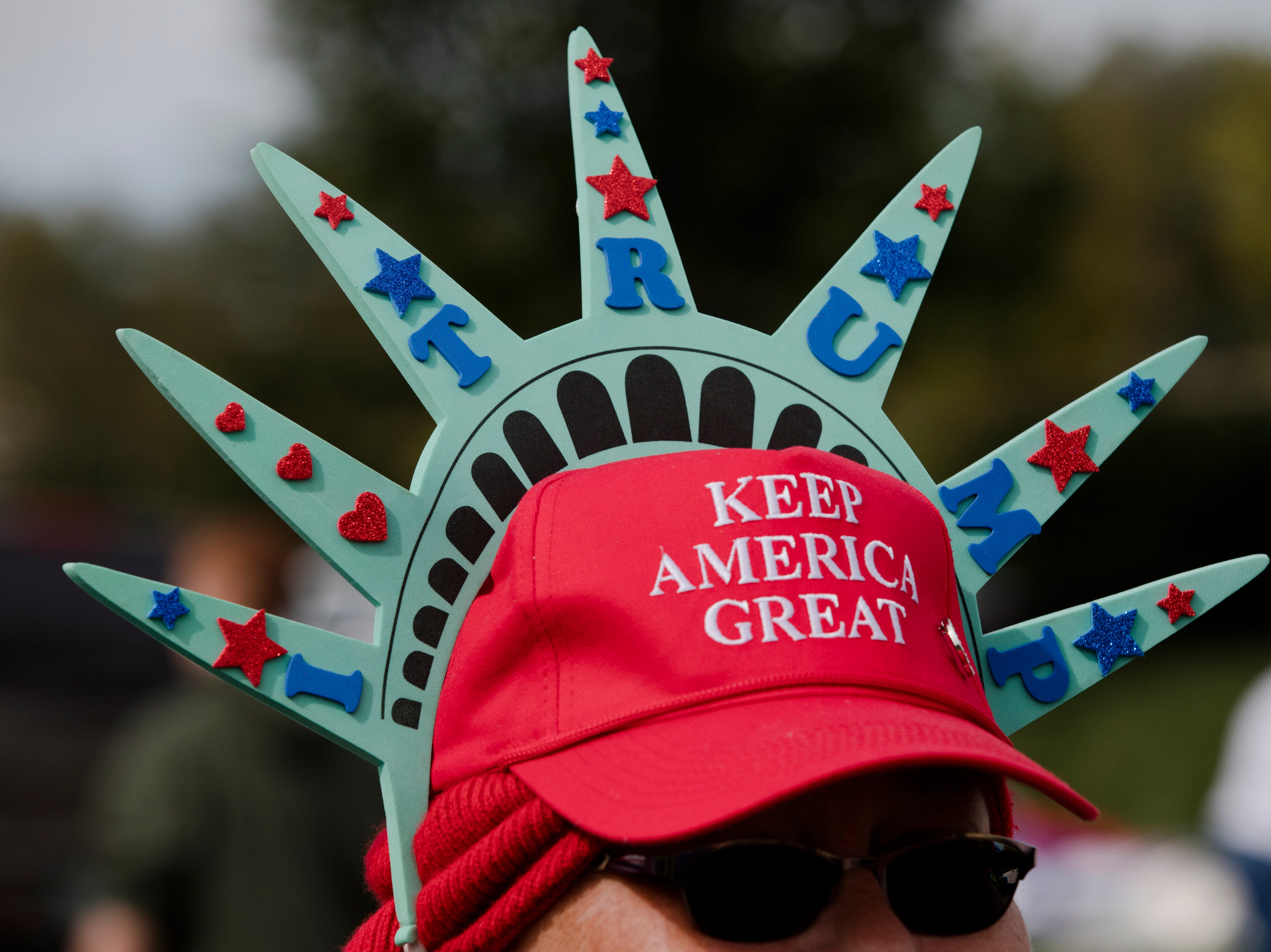 Toni Eaton dressed as lady liberty waits in line for President Donald J. Trump's Make America Great Again Rally in Lebanon, Ohio, on Friday, Oct. 12, 2018.