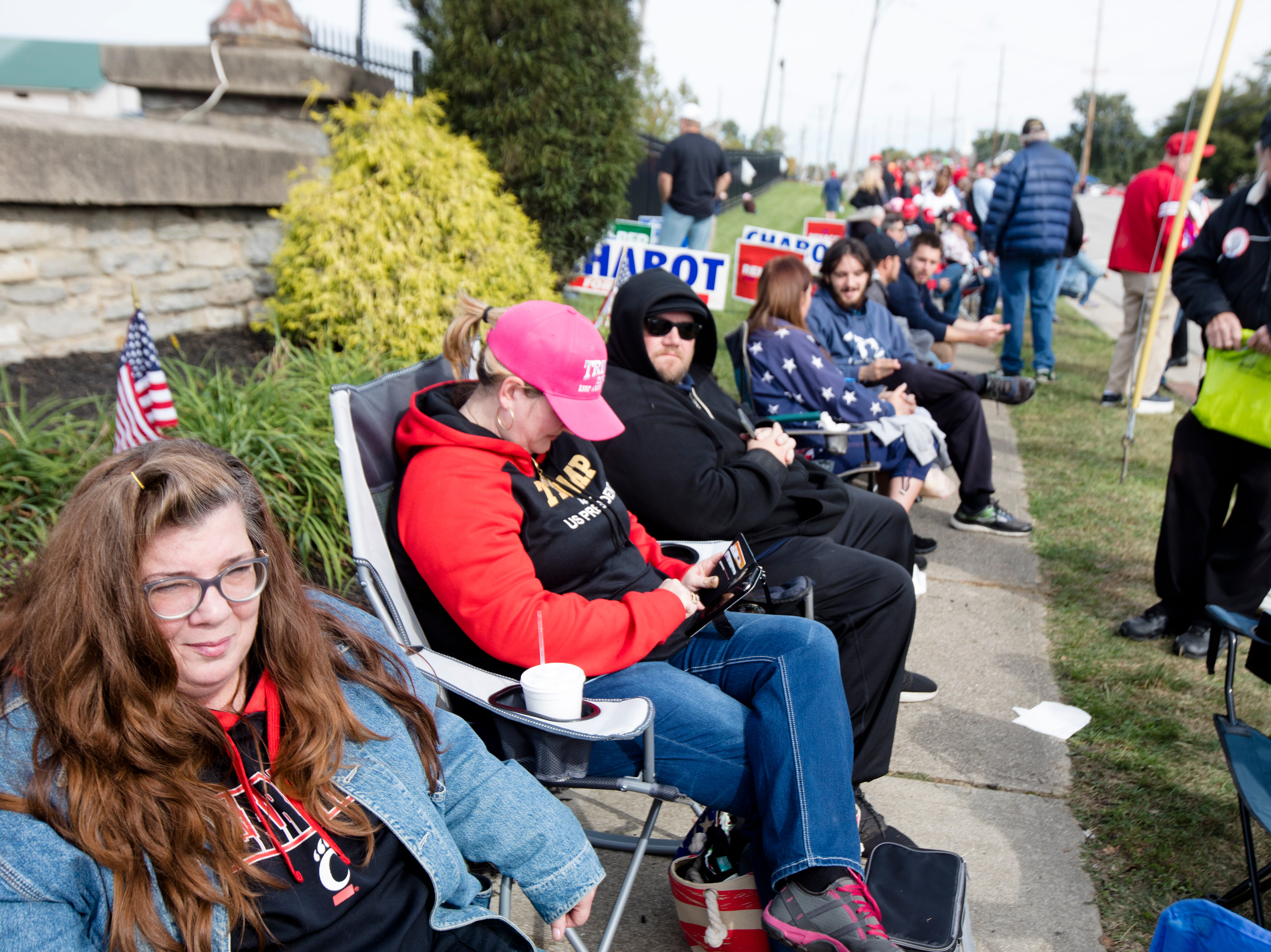 Meldia Kinman, of Williamsburg, Ohio, sits in a chair at the front of the line for President Donald J. Trump's Make America Great Again Rally in Lebanon, Ohio, on Friday, Oct. 12, 2018. Kinman said she arrived the night before to have a good spot in line.