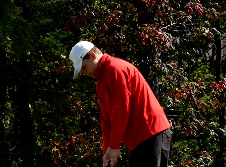 A.J. Kontsis of Oak Hills sends his 18th hole putt to the cup at the 2018 Southwest District Golf Tournament in Beavercreek, Ohio, October 11, 2018.