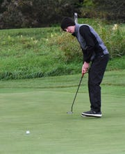 Kyle Schmidt of Lakota East watches his putt for par inch to the hole at the 2018 Southwest District Golf Tournament in Beavercreek, Ohio, October 11, 2018.
