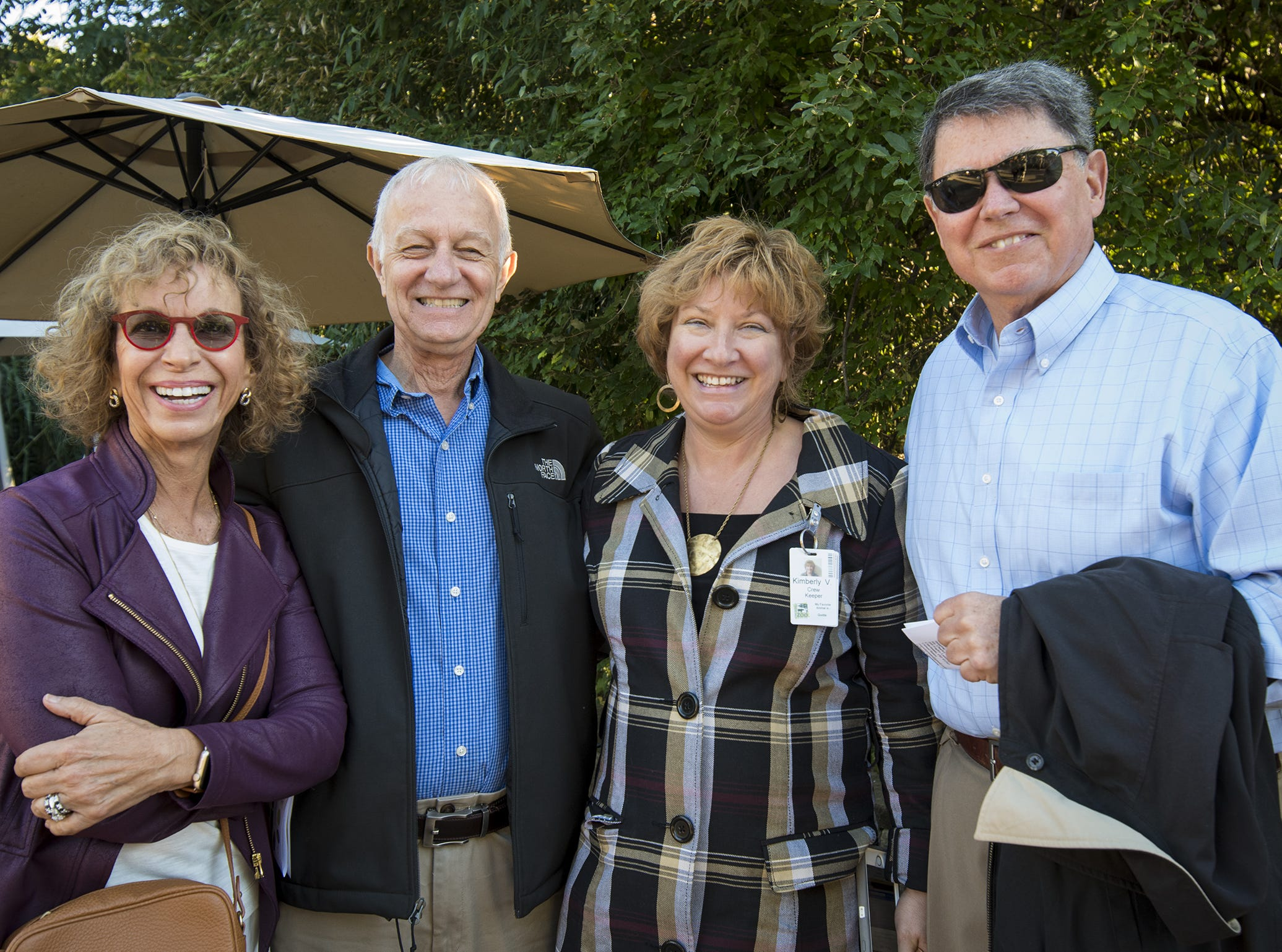 Linda Moore, Rick Serge, Kim Vonder Meulen and Charlie Gentry attend Zoo Brew.