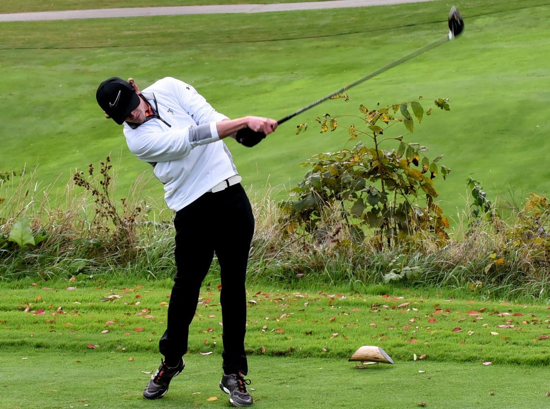 Loveland's Jeffrey Main follows through on a tee shot at the 2018 Southwest District Golf Tournament in Beavercreek, Ohio, October 11, 2018.