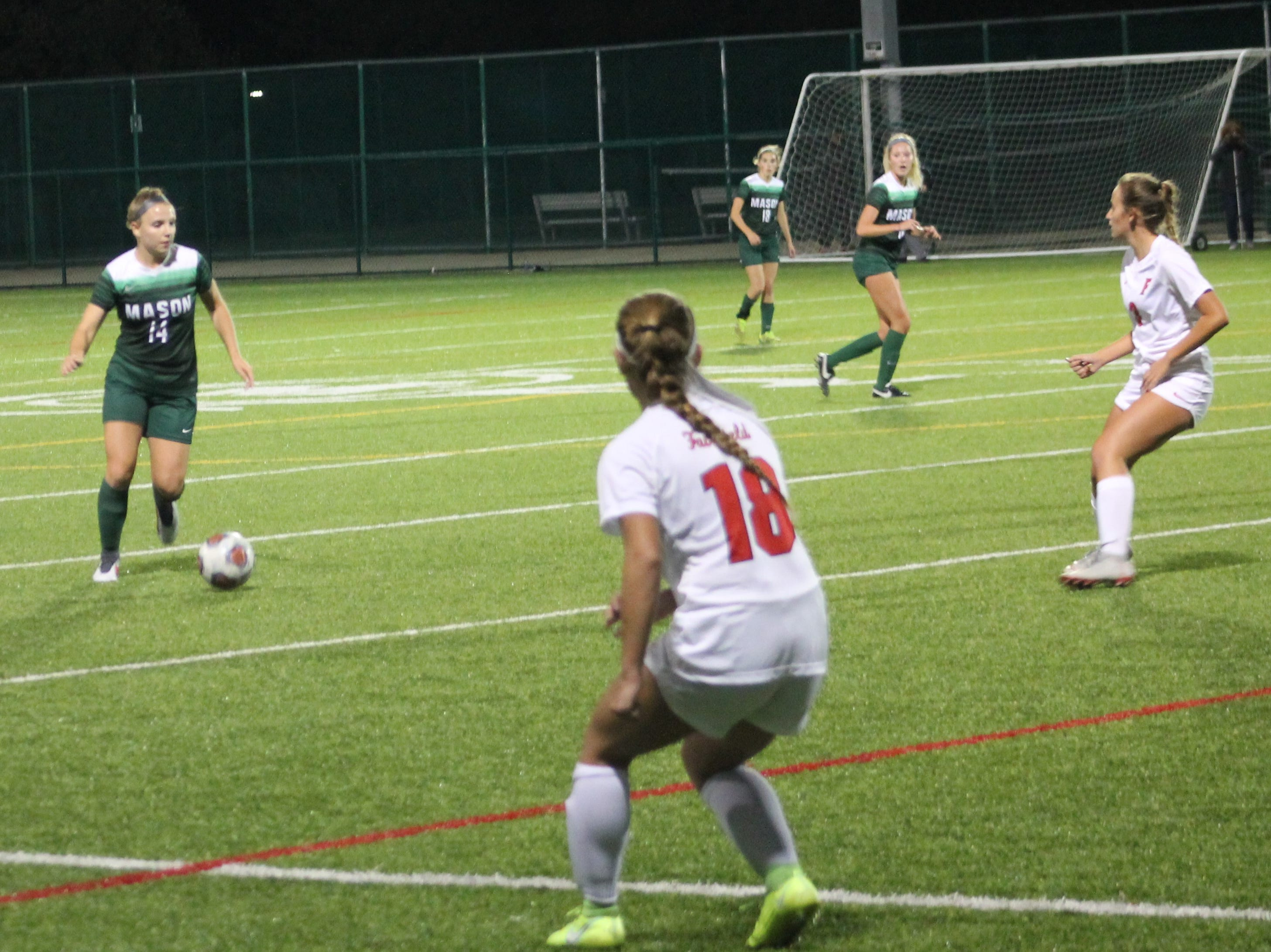 Mason senior midfielder Olivia Polnow has Fairfield back on their heels