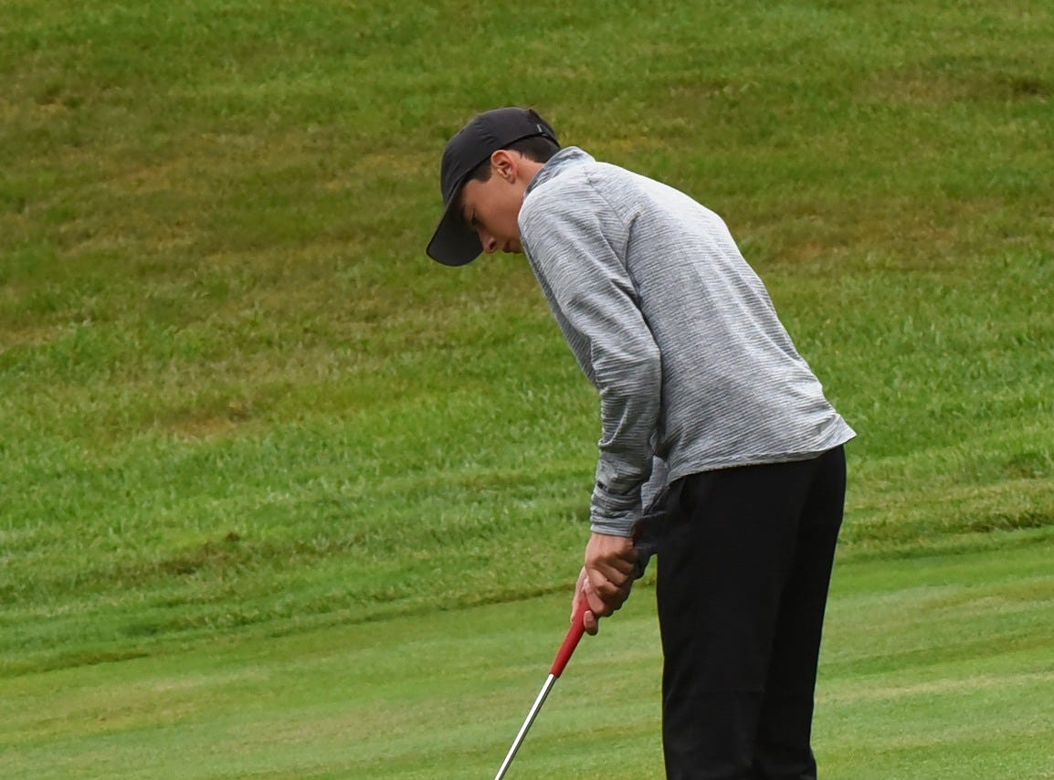 Ty Sylla of Lakota East eyes a par putt for the Thunderhawks at the 2018 Southwest District Golf Tournament in Beavercreek, Ohio, October 11, 2018.