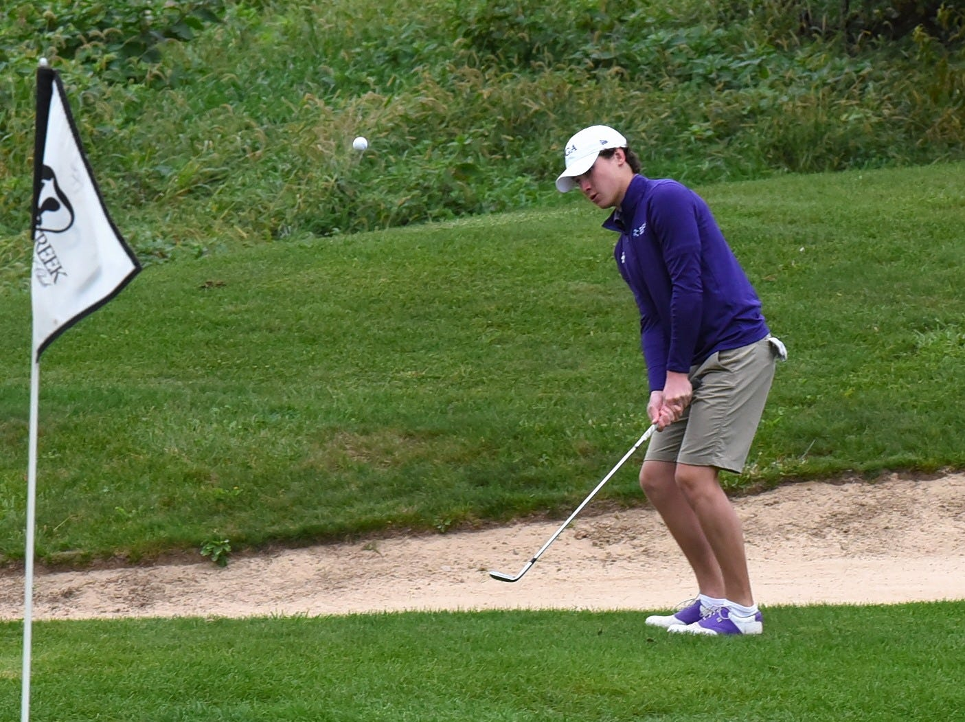 Jack Baker of Elder pitches to the green at the 2018 Southwest District Golf Tournament in Beavercreek, Ohio, October 11, 2018.